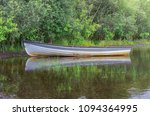 reflections of a rowing boat ... | Shutterstock . vector #1094364995