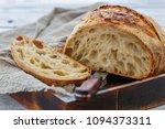 cut loaf of artisanal wheat... | Shutterstock . vector #1094373311