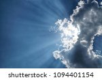 a beam of the sun behind the... | Shutterstock . vector #1094401154