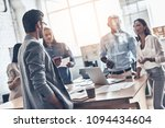 brainstorm meeting. group of... | Shutterstock . vector #1094434604