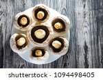 peeled champignons in a plate... | Shutterstock . vector #1094498405