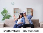 young couple trying virtual... | Shutterstock . vector #1094500031