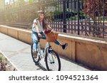 happy woman on bike cycling...   Shutterstock . vector #1094521364