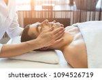 facial massage. handsome man... | Shutterstock . vector #1094526719