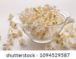 Glass Bowl Of Popcorn Isolated...