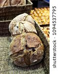 Small photo of Dark bread with raisins on the market in a wicker basket. The market in Jerusalem.