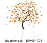 autumn tree with falling leaves ...