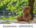 brown teddy bear sitting on... | Shutterstock . vector #1094554541