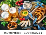 bavarian sausages with pretzels ... | Shutterstock . vector #1094560211