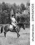 girl jockey riding a horse | Shutterstock . vector #1094569205