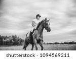 girl jockey riding a horse | Shutterstock . vector #1094569211