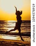 cheerful girl runs along the... | Shutterstock . vector #1094578919
