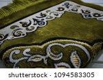 green prayer mat | Shutterstock . vector #1094583305
