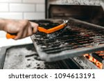 cook hands with metal brush... | Shutterstock . vector #1094613191