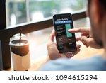 mobile banking. man using... | Shutterstock . vector #1094615294
