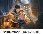 family bedtime. mom and child... | Shutterstock . vector #1094618681