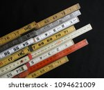 Small photo of Folding rulers in metric and inch measurement represent concepts of accuracy, craftsmanship and precision.