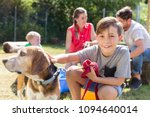 family taking home a dog from... | Shutterstock . vector #1094640014