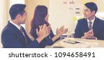 business team is clapping... | Shutterstock . vector #1094658491