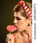 woman eating lollipops. girl in ... | Shutterstock . vector #1094684771