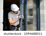 handsome young man installing... | Shutterstock . vector #1094688011