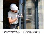 handsome young man installing... | Shutterstock . vector #1094688011