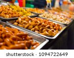 sausages displayed at local... | Shutterstock . vector #1094722649