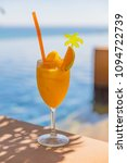 mango juice in glass at poolside | Shutterstock . vector #1094722739