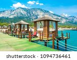 wooden beach pavilions on the... | Shutterstock . vector #1094736461