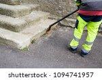 man burn weeds with torch ... | Shutterstock . vector #1094741957