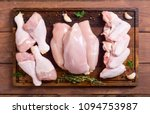 raw chicken meat on cutting... | Shutterstock . vector #1094753987