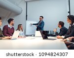 group of coworkers laughing... | Shutterstock . vector #1094824307