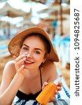 sunscreen   sunblock. woman...   Shutterstock . vector #1094825687