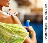 applying sunscreen on a shoulder | Shutterstock . vector #1094829425