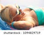woman in sunglasses relaxing... | Shutterstock . vector #1094829719