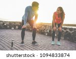 fit couple taking a rest after... | Shutterstock . vector #1094833874