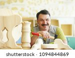 smile and happy woodworker in...