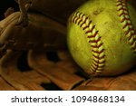 Yellow Softball In A Brown...