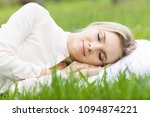 young woman sleeping on white... | Shutterstock . vector #1094874221