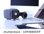 virtual reality goggles on desk ... | Shutterstock . vector #1094880059