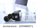 virtual reality goggles on desk ... | Shutterstock . vector #1094880071
