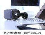 virtual reality goggles on desk ... | Shutterstock . vector #1094880101