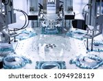 automatic robot in assembly... | Shutterstock . vector #1094928119