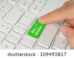 Hand Pushing Go Green Button On ...