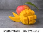 mango on a dark background ... | Shutterstock . vector #1094950619