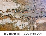 Small photo of Blurry cement concrete wall cracking on ground. Cracked surface from earthquake.