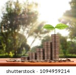money growing from coins  | Shutterstock . vector #1094959214