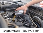 the repairman is changing the... | Shutterstock . vector #1094971484