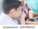 little boy learning anatomy... | Shutterstock . vector #1094986925
