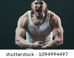 angry professional bodybuilder... | Shutterstock . vector #1094994497
